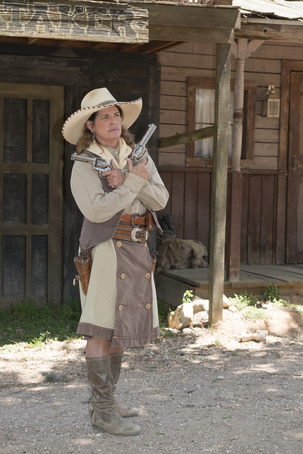 """""""Pistol Packin' Paula"""" Saletnik is the resident gun-twirler, trick roper, bull-whipper & western dancer at the Enchanted Springs Ranch, an Old West theme park, special-events venue, and frequent movie and television commercial set in Boerne, Texas, northwest of San Antonio"""