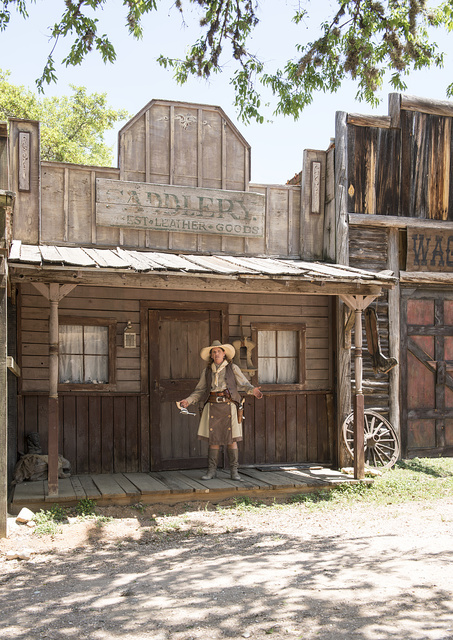 """""""Pistol Packin' Paula"""" Saletnik is the resident gun-twirler, trick roper, bull-whipper & western dancer at the Enchanted Springs Ranch and Old West theme park, special-events venue, and frequent movie and television commercial set in Boerne, Texas, northwest of San Antonio"""