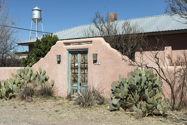 Prickly-pear cacti outside a modernist adobe residence in Marfa, in Presidio County, Texas