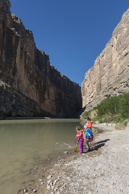 Prior to setting off on a canoe trip through Santa Elena Canyon, deep in Big Bend National Park in Brewster County, Texas, Cara Berkman and her daughters, Abby, Katie and Hannah Berkman, check the relatively low level of the Rio Grande River. Mexico is to the left, the United States to the right