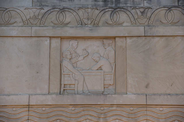 Relief, carved by Herring Coe, on the facade of the 1937 First National Bank Building, now (as of 2014) abandoned, in downtown Beaumont, Texas. Details on the building celebrate Beaumont industry and depict various workers and professionals in carved limestone