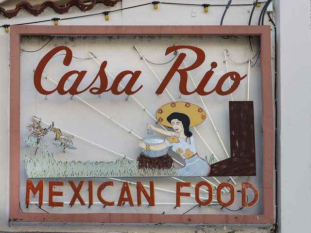 Restaurant sign above the River Walk, also known as the Passeo del Rio, a network of walkways along the banks of the San Antonio River, one story beneath the streets of Downtown San Antonio, Texas