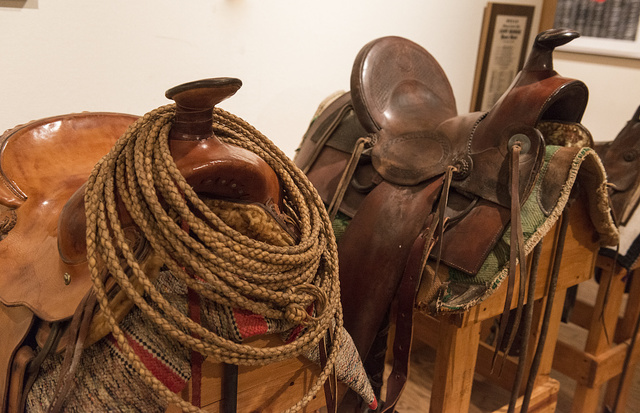 Saddles belonging to local rancher Watt Reynolds, on display at the Old Jail Art Center in Albany, Texas, seat of Shackelford County. The smaller one on the right was given to him when he was four as a present in compensation for his having missed the world's fair of 1903 in St. Louis