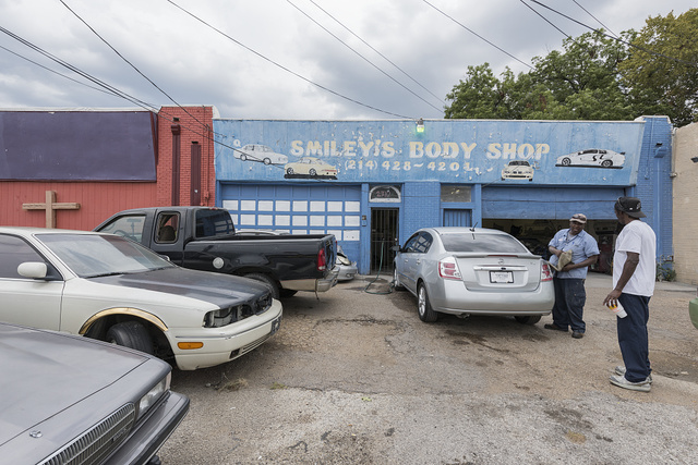 Scene at Smiley's Body Shop, an auto-repair shop in a modest neighborhood of Dallas, Texas