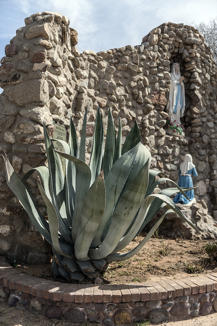 Small grotto outside the chapel of San Elizario, founded in 1789, is often mistaken for a Spanish mission, since it lies quite near two missions in nearby El Paso, Texas