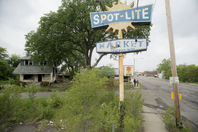 "Spot Lite, Tireman at Hazlett, Detroit, 2014.  ""The Neighborhood is hurt by not having a market,"" commented a passerby"