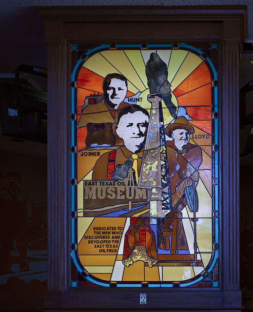 """Stained-glass tribute to Texas oil pioneers H.L. Hunt, """"Dad"""" Joiner, and """"Doc"""" Lloyd at the East Texas Oil Museum on the campus of Kilgore College in Kilgore, Texas"""