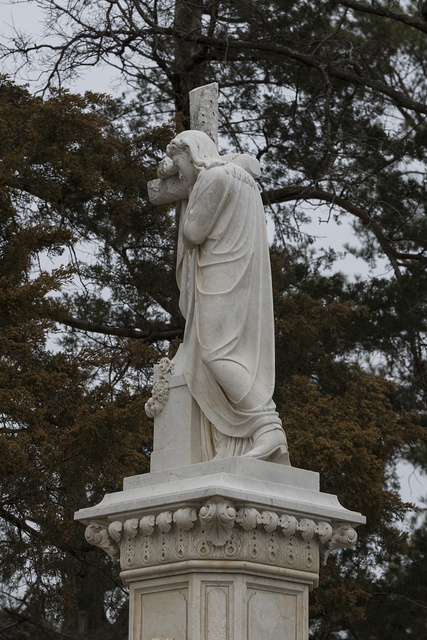 "Statues of Jesus, some say this is an unidentified angel, are not unusual in American cemeteries. Nor are monuments like this one at the grave of small-town businessmen. What makes the statue at this final resting place of Willet Babcock in Paris's Evergreen Cemetery unusual and uniquely ""Texas"" are the cowboy boots that the robed figure depicted is wearing"