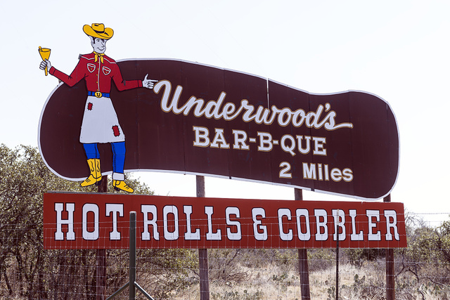 """Street sign for a barbecue restaurant in Brownwood, the seat of Brown County in Central Texas. Texas vies with North Carolina and the city of Kansas City as avowed """"barbecue capitals"""" of the country"""