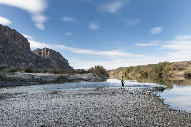 Stroller on the shoreline of the Rio Grande River in Big Bend National Park, Texas