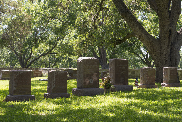 """The Johnson Family Cemetery on the grounds of the LBJ Ranch near Stonewall, Texas. The two slightly larger middle stones mark the final resting places of First Lady Claudia Taylor """"Lady Bird"""" Johnson (somewhat more brightly illuminated by the sun) and President Lyndon B. Johnson"""
