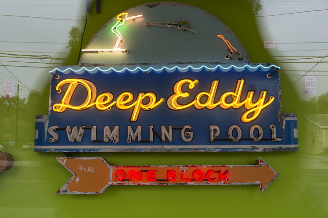 This looks like one of the funky artistic neon signs that are everywhere in the eclectic South Austin neighborhood of Austin, Texas. It is that, perhaps, but it also directs one to the actual Deep Eddy municipal pool