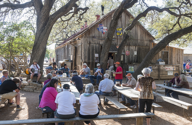 Tourists each barbecue in Luckenbach, Texas, a dot of a place in Gillespie County, Texas