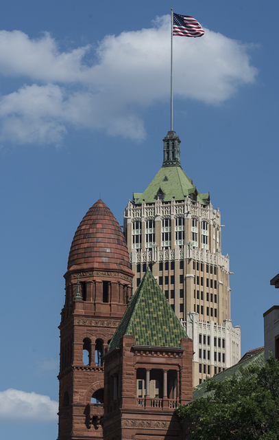 Two San Antonio, Texas, landmarks are captured in the same frame: In the foreground is architect J. Riely Gordon's 1897 Bexar County Courthouse; in the rear, the 1929 terra cotta-clad Tower Life Building (originally the Smith-Young Tower, designed by Ayres & Ayres)