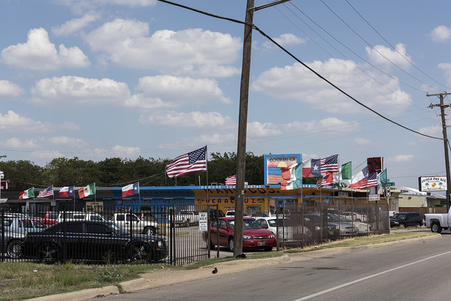 Used-car dealership that touts its American, Mexican, and Texas loyalty in Grand Prairie, Texas, along old Texas Route 180, formerly the main road between Fort Worth and Dallas