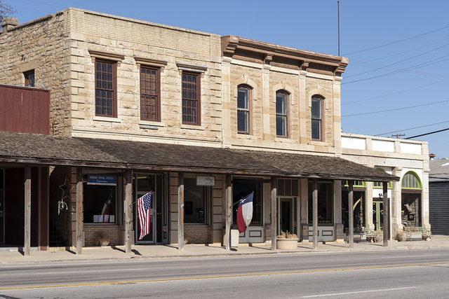 View of downtown Albany, Texas, seat of Shackelford County. The portion of the adjoined brown buildings to the left is Albany's City Hall