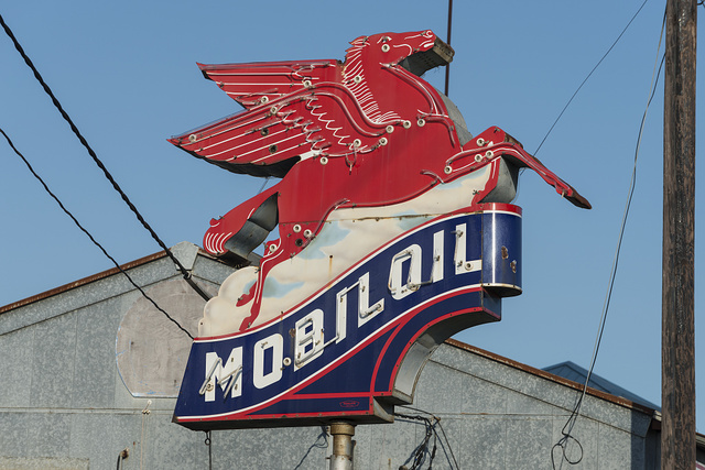 Vintage Mobil pegasus (flying horse) gas station insigia along a road in East Texas
