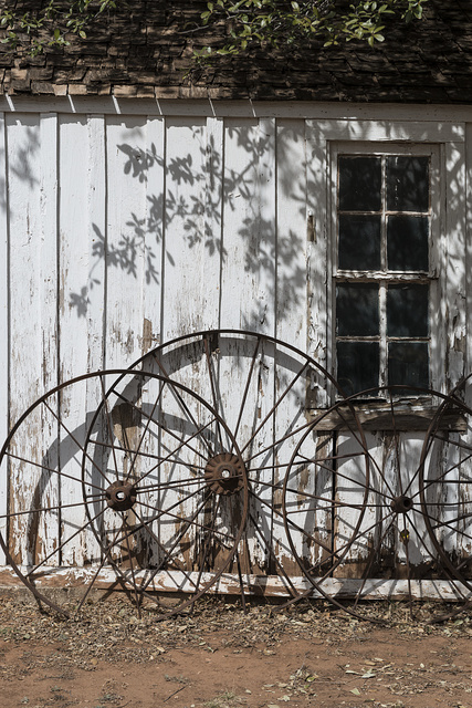 Wagon wheels against a building at the Buffalo Gap Historic Village in the unincorporated Taylor County, Texas, town of the same name, near Abilene