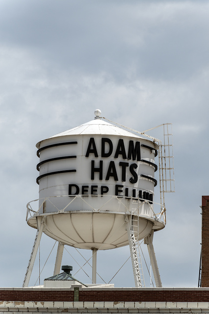 Water tower above the Adam Hats Building in the Deep Ellum section of Dallas, Texas