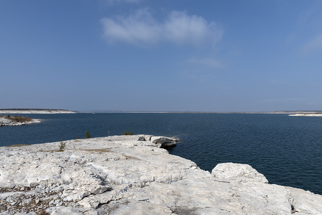 Waterside view of the Amistad National Recreation Area, at the confluence of the Rio Grande, Devils, and Pecos rivers near Del Rio, Texas. The reservoir created there by the Amistad dam is famous for its deep and dangerous underwater caves, popular with elite scuba divers