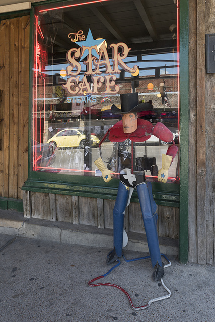 Western-themed street figure outside the Star Cafe in the Stockyards District of Fort Worth, Texas