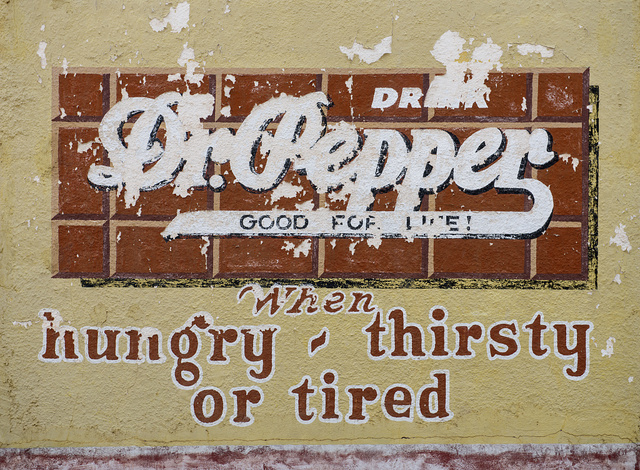 What's left of an old Dr. Pepper beverage advertising sign on the wall of a vintage gas station at the Buffalo Gap Historic Village in the unincorporated Taylor County, Texas, town of the same name, near Abilene