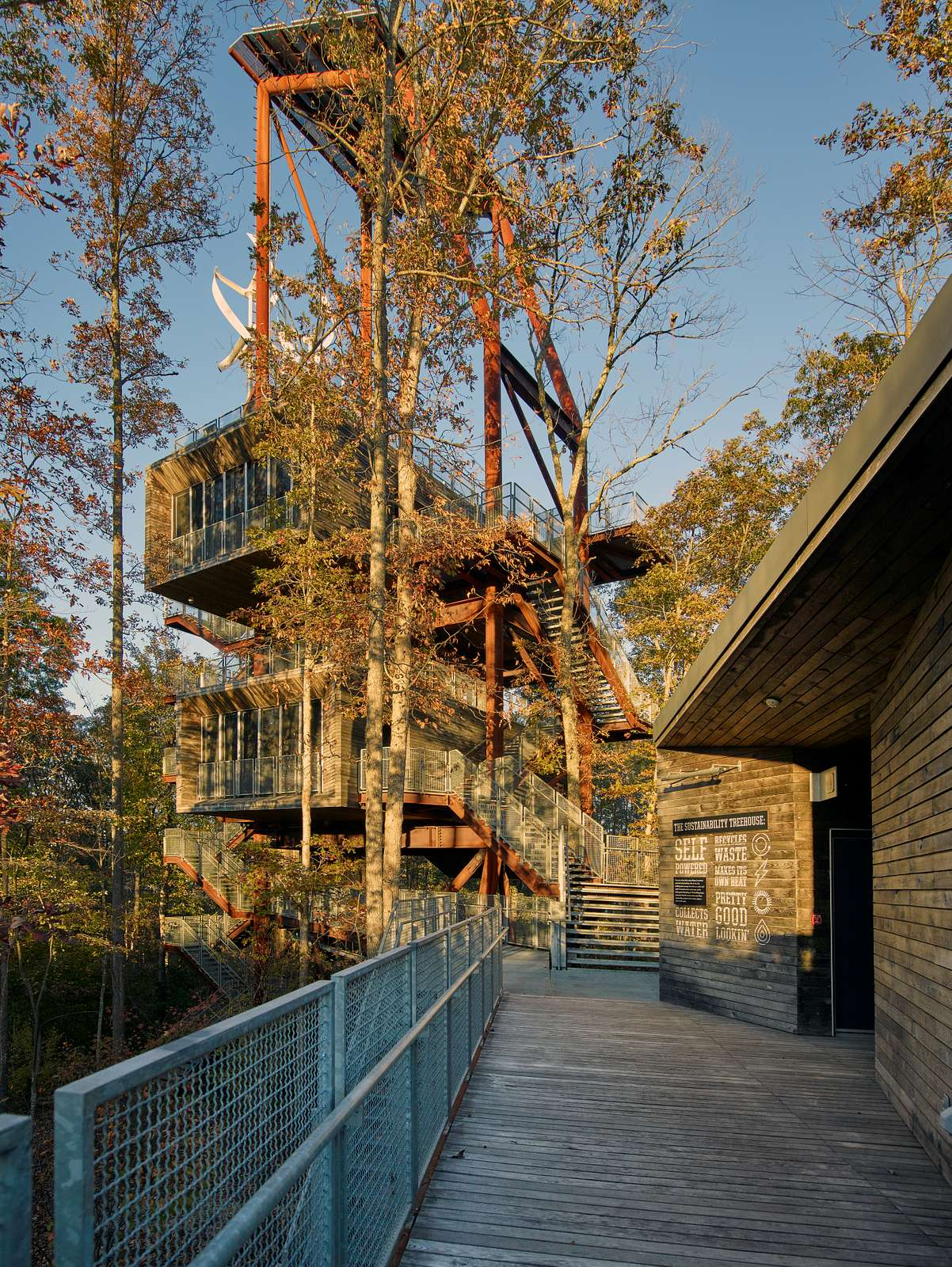 """A gigantic """"tree house,"""" actually the San Francisco-based Mithun architecture firm's freestanding, steel-frame-supported Sustainability Treehouse that is often even more hidden amid the evergreens, at the Summit Bechtel Reserve, site of annual National Scout Jamboree (and sometimes international scouting retreats as well) in the sprawling wilderness near the tiny town of Glen Jean and the New River Gorge in West Virginia"""