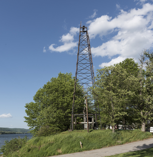 An oil derrick that has long marked the spot of an almost two-century-old ferry landing, now (in 2015) named for longtime ferry board president John Eckels, in Sistersville, West Virginia