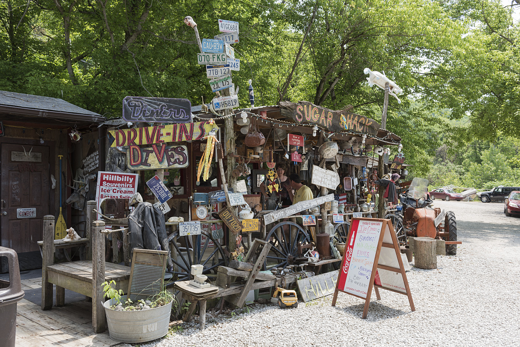 Remnants from the backwoods at the Hillbilly Hot Dogs stand along West Virginia Route 2 along the Ohio River in rural Cabell County. The stand is augmented by several displays that make light of the state's pejorative hillbilly stereotype