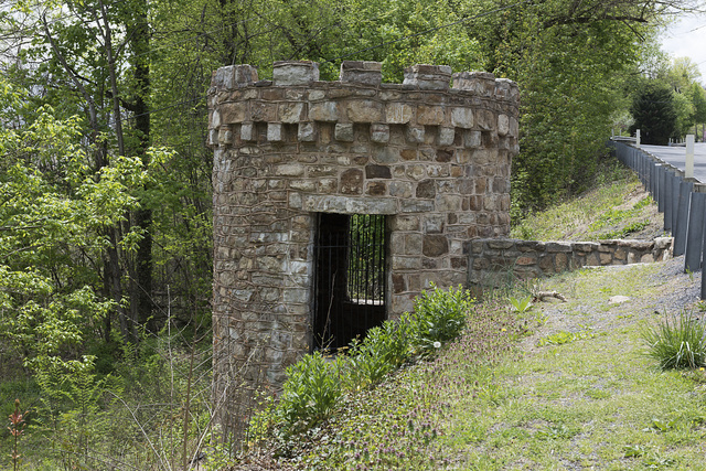 Small turret across the road from the Berkeley Springs Castle. It may have been used as a place marker on the twisting road, along which visitors can otherwise easily pass the castle high above without seeing it. Berkeley Springs, West Virginia
