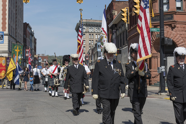The procession winds its way through downtown Clarksburg at the annual North Central West Virginia Scottish Festival and Celtic Gathering parade that ends with a celebration at Clarksburg's First Presbyterian Church