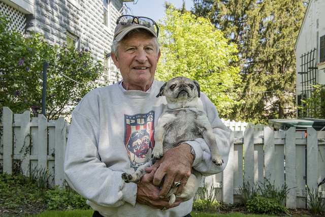 Tony Catanese, owner of the Camp Bed and Breakfast Inn in Harpers Ferry, West Virginia, in his Pug T-shirt and with his pug dog, Blossom