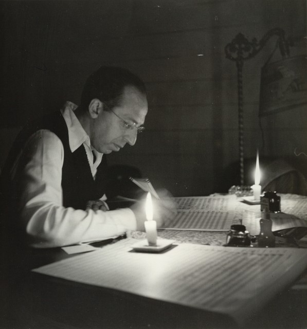 Aaron Copland by candlelight, studio in the Berkshires, September, 1946