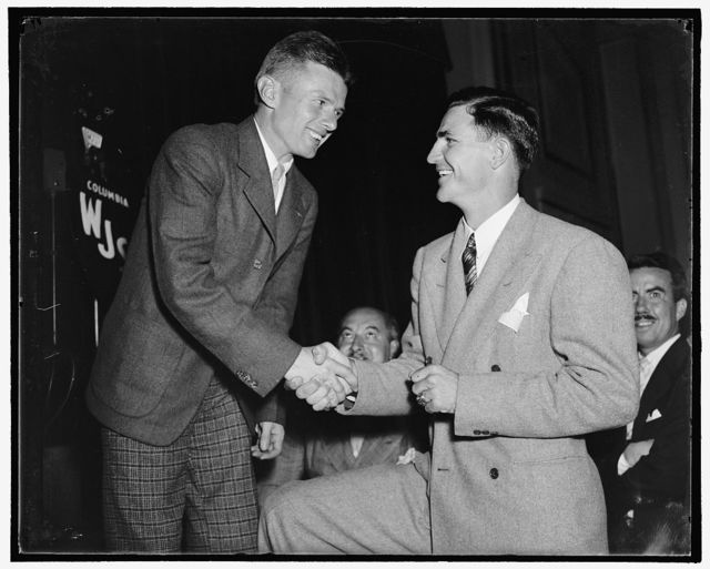 "Ace passer and wrong way flyer meet. Washington, D.C., Aug. 11. Champions in their fields. Doug ""Wrong Way"" Corrigan, who was warmly welcomed in the Nation's Capitol, greets Sammy Baugh, Ace Passer of the Washington Redskins Professional Football team, at a reception at the National Press Club, 8/11/38"