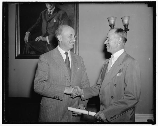 Admiral Waesche sworn in for another four years. Washington, D.C., June 13. Today at the Office of the Secretary of the Treasury, Admiral Russell Randolph Waesche, was reappointed for another four years to the office of Commandant of the Coast Guard. Seen in the picture is Secretary of the Treasury Henry Morgenthau Jr. as he congratulates Admiral Waesche on his reappointment