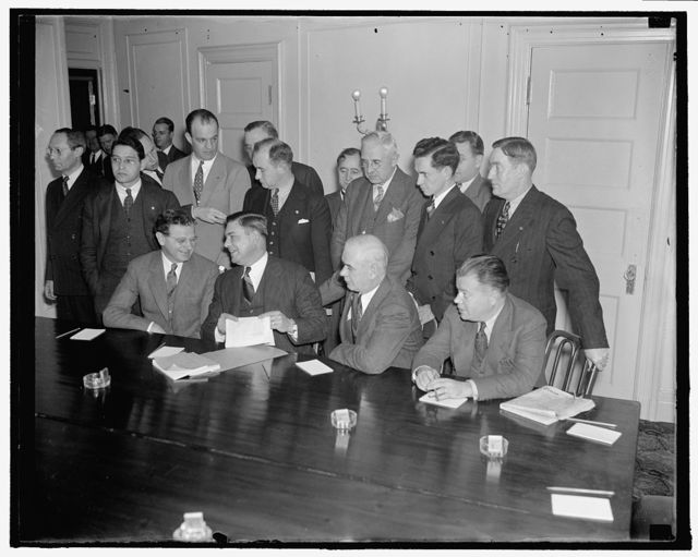 A.F. of L. and C.I.O. start peace conferences. Washington, D.C., Oct. 25. Labor leaders named by the CIO and A.F. of L. to attempt to find a basis for peace between the two warring factions of organized labor are sown here at the opening of the Peace Parley at the Willard Hotel here today. Seated, left to right: Sidney Hillman, Amalgamated Clothing Workers, CIO; George M. Harrison, Brotherhood of Railway Clerks, AFL.; Phillip Murray, United Mine Workers, CIO; David Dubinsky, International Ladies Garment Workers, CIO. Standing, left to right: Abram Flaxer, CIO; Joseph Curran, National Maritime Union, CIO; Harvey Fremming, Oil Workers Union, CIO; Michael J. Quill, Transport Workers Union, CIO; Matthew Woll, Photo Engravers Union, AFL; G.M. Dugnizaet, International Electrical Workers, AF of L; Homer Martin, U.A.W., CIO; James Garey, CIO; S.H. Dalrymple, United Rubber Workers, CIO. 10/25/37