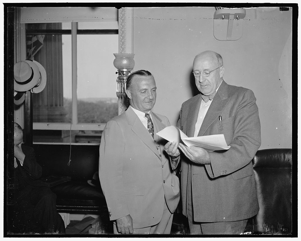 Air Corps Chief before Senate Committee. Washington, D.C., May 24. Maj. Gen. Oscars Westover, (left) Chief of the U.S. Army Air Corps, with Senator Elbert D. Thomas of Utah, Chairman of the Senate Military Affairs Subcommittee now conducting hearings on the Helium gas bill. Gen. Westover is expected to testify tomorrow, 5/24/37