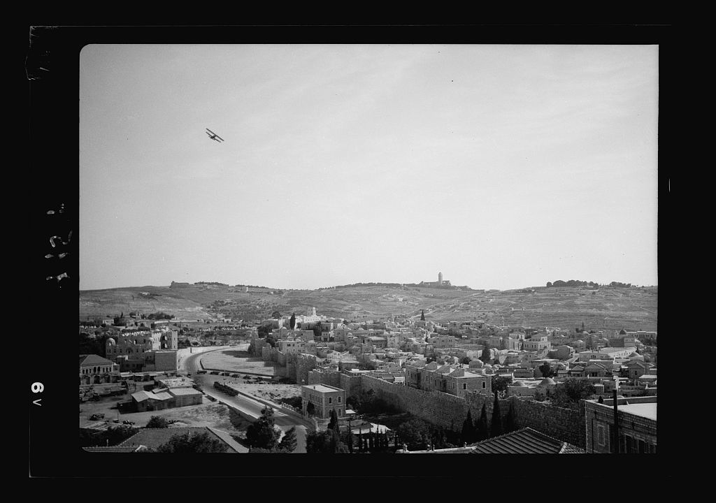 Airplane over Jerusalem & military force at Damascus Gate seen from roof of Notre Dame bld'g. [i.e., building]
