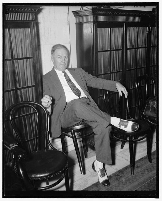 All alone. Washington, D.C., Aug. 13. Senator Edward R. Burke, who bitterly opposed the president's court reorganization bill and likewise opposed the nomination of Senator Black, sits in a corner and observes the Senate Judiciary Subcommittee approve the nomination of Black by a vote of 5-1, 8/13/37