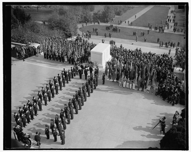 American Legion pays tribute to one of their buddies. Washington, D.C., Nov. 11. Scene at the Tomb of the Unknown Soldier today as the American Legion paid tribute to one of there buddies in solemn Armistice Day ceremonies. Stephen Chadwich, National Commander, is pictured placing the wreath, 11/11/38