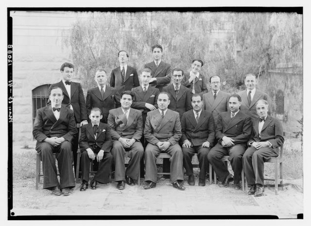 Arab staff at the P.B.S. [i.e., Palestine Broadcasting Service] Other smaller group with messenger boys