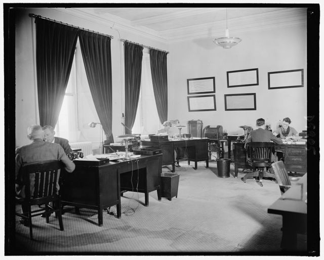 Archie Lockhead's office. He is facing camera on extreme left, 2-23-39
