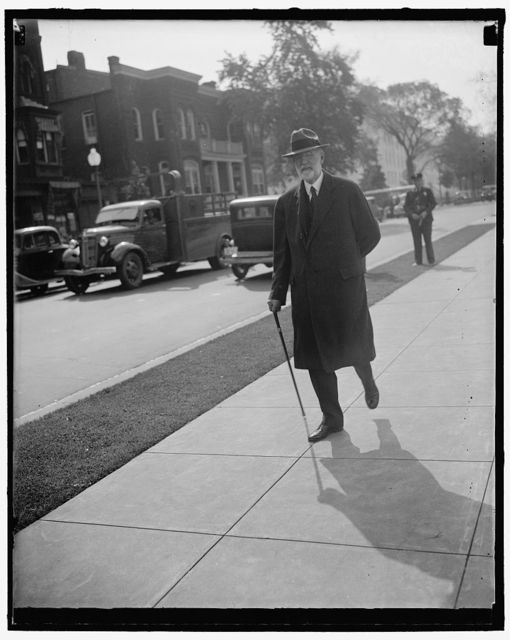 Arrives for Supreme Court Session. Washington, D.C., Oct. 11. Associate Justice George Sutherland of the United States Supreme Court arriving for today's session of the Court, 10/11/37