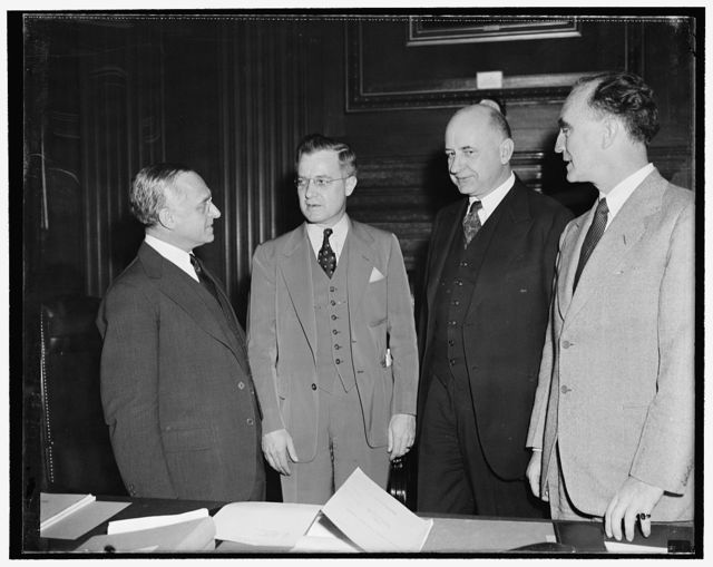 As special presidential committee began public hearings on possible civil service reforms. Washington, D.C., Nov. 1. Rep. Robert Ramspeck, chairman of the House Civil Service Committee, was the first witness today as open hearings began before the special presidential committee established to study possible reforms in recruiting governmental legal help. In differing with Justice Felix Frankfurter, a member of the committee, Ramspeck said 'that he did not think the fact that a man graduates from Harvard, Yale, or Columbia or some other school should control his appointment.' In the photograph, left to right: Associate Justice Felix Frankfurter, Rep. Ramspeck, Justice Stanley F. Reed, chairman of the committee, and Attorney General Frank Murphy, also a member of the committee