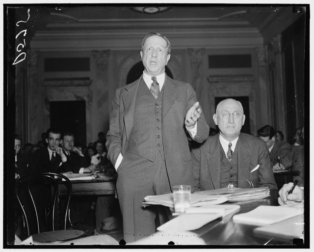 At Civil Liberties hearing. Washington, D.C. Jan. 14. Borden Burr, Counsel for the Tennessee Coal, Iron and Railroad, testifying before the Senate Civil Liberties hearing into labor disputes and flogging cases in Alabama, charged that failure of law enforcement in their district made it imperative for his company to bring in special deputies to protect life and property. Karl L. Landgrebe, Vice President of the Toi, is shown seated