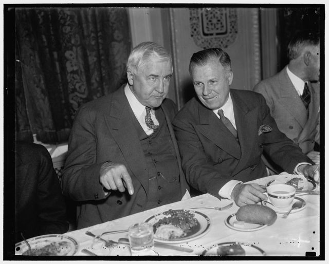 At Rayburn luncheon. Washington, D.C., Jan. 9. No doubt, this conversation was along monetary lines: Jesse Jones, Chairman of the R.F.C. and J.F.T. O'Connor, Comptroller of the Currency, as they attended the luncheon given in honor of Rep. Sam Rayburn, new Majority Leader of the House. The Texas Club played host at the National Press Club