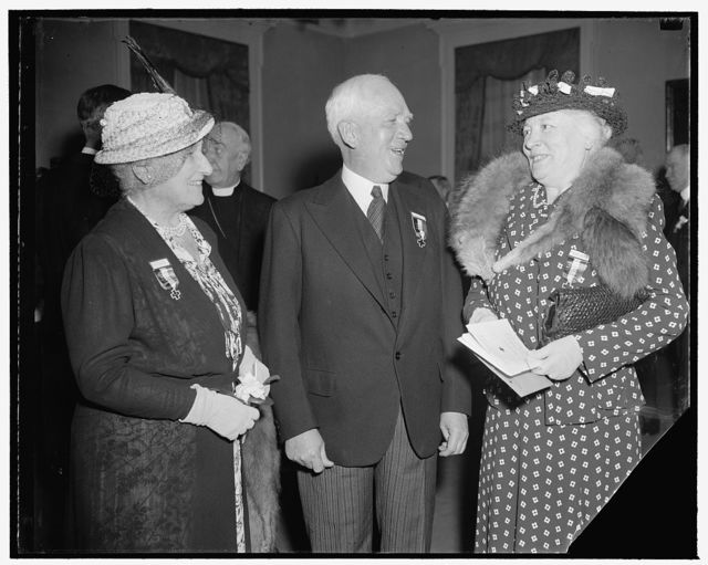 Attend American Red Cross convention. Washington, D.C., April 24. Prominent members of the American Red Cross on hand for the opening session of the annual convention of the organization today were, left to right: Mrs. Henry R. Rea, member of the Central Committee, Chairman Norman Davis, and Mrs. August Belmont of New York, also a member of the Central Committee