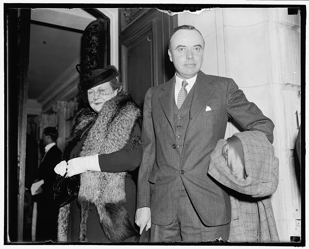 Attend Soviet party Washington, D.C., Nov. 7. Wage-Hour Administrator and Mrs. Elmer Andrews as they arrive to attend the party at Soviet Embassy today which marked the 21st anniversary of the October Socialist Revolution