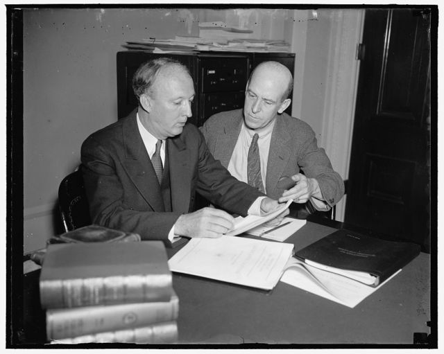 Authors of Administration Minimum Wage and Maximum Hours of Work Bill. Washington, D.C. May 24. Senator Hugo L. Black, (left) democratic senator from Alabama and Chairman of the Senate Committee on Education and Labor, and Rep. William P. Connery Jr, of Massachusetts Chairman of the House Labor Committee, study the bills they introduce today in the Senate and [...] for enactment of a standard wage scale and [minim]um hours of work law. The bills were introduced [...] after President Roosevelt's address demanding [...w] was read to both Houses of Congress. [...] call for a minimum of 40 cents an hour [mini]mum hours comprimise a 35 to 40 hour work [week], 5/24/37