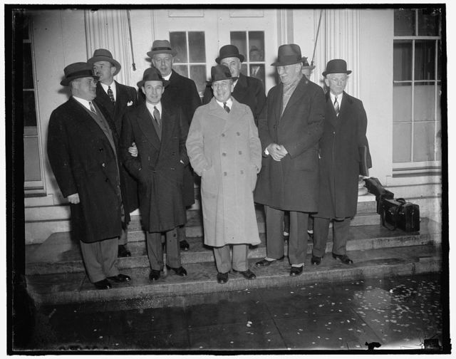 Auto manufacturers confer with Roosevelt. Washington, D.C., Jan. 21. Big shots of the auto industry shown leaving the White House after conferring with President Roosevelt, the group approved the President's credit selling recommendations and forecast as spring upturn in motor sales which should improve business generally. Left to right, front row: K.T. Keller, Chrysler President; Edsel Ford; Sen. Prentiss M. Brown of Mich, who arranged the meeting; William S. Knudsen, President of General Motors; and A.E. Duncan, President of Comm. Credit. Co., 1/21/38